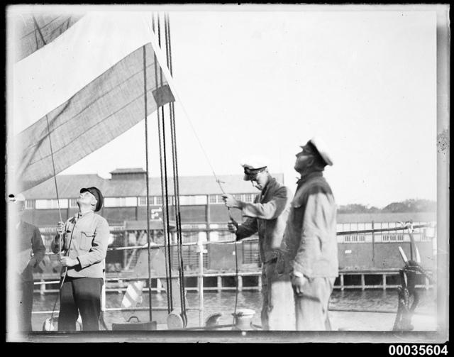 Hoisting the German Imperial flag on MAGDALENE VINNEN