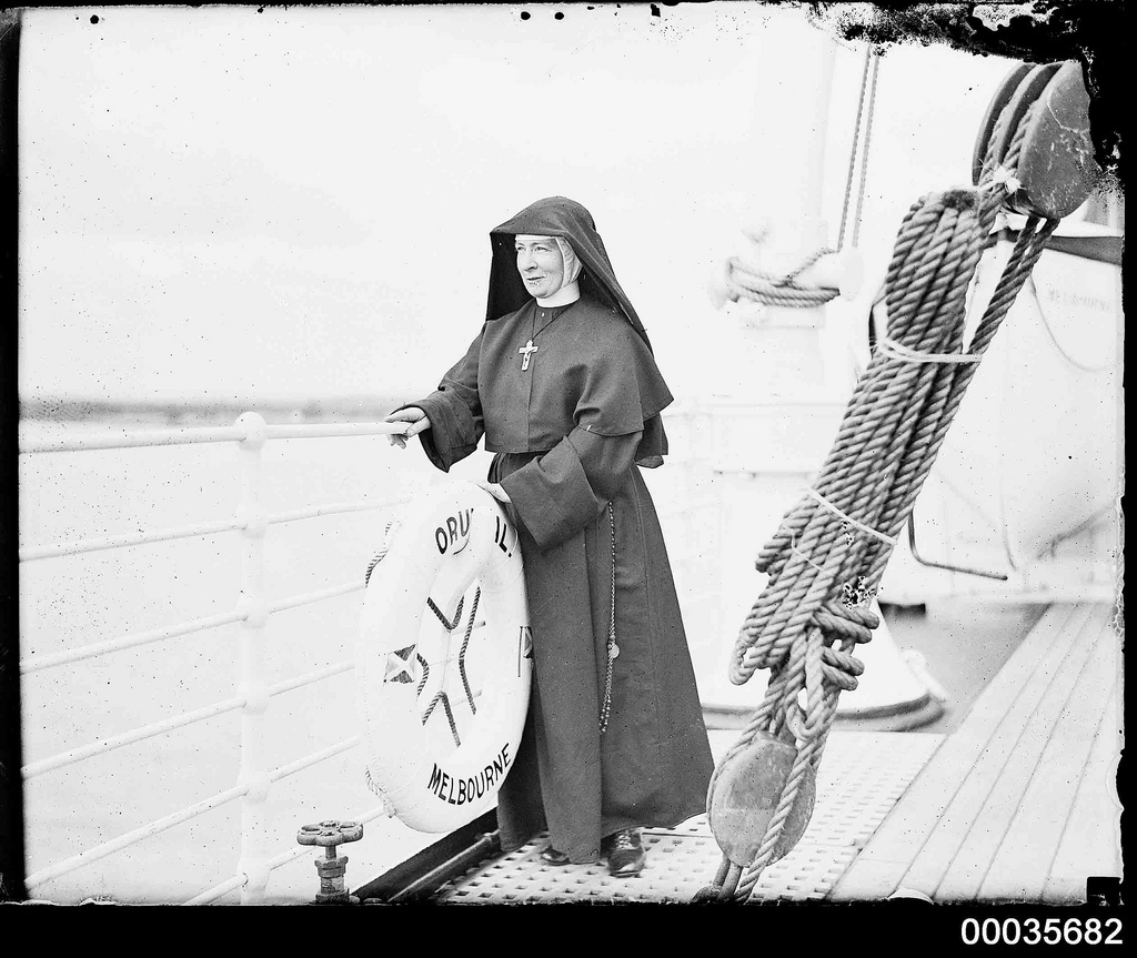 Nun standing on the deck of SS ORUNGAL, c 1930