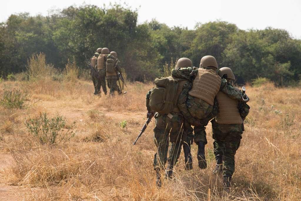 Rwanda Defense Force soldiers carry mock casualties