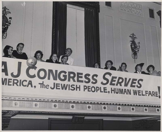 """Banner reads """"A J Congress Serves America, the Jewish People, Human Welfare!"""" at the National Convention, Women's Division, 1953"""