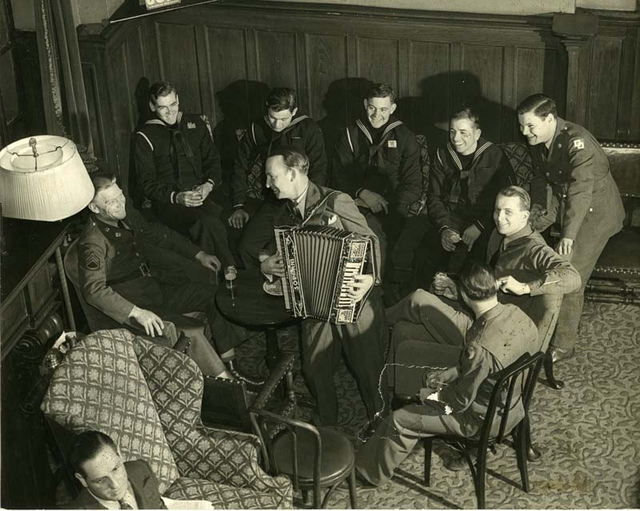 City Athletic Club, members seated and listening to accordion player
