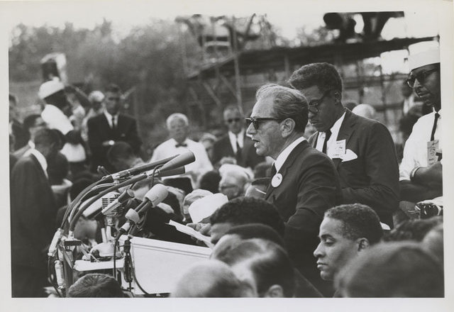 Joachim Prinz speaking at March on Washington, with Bayard Rustin pictured, 1963