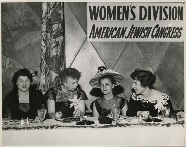 Justine Wise Polier and Eleanor Roosevelt conversing with Women's Division members at Annual Hanukkah Luncheon