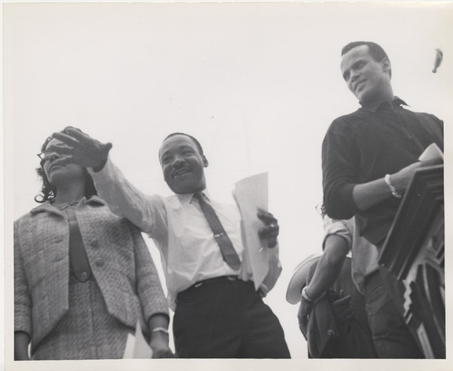 Martin Luther King, Jr. and Harry Belafonte near podium at Montgomery March