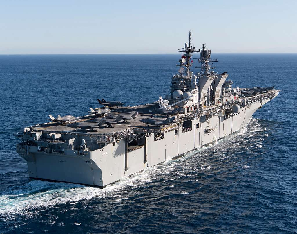 Overall view of USS America (LHA-6) with loaded deck of F-35Bs, MV-22s, MH-60S, AH-1Z and UH-1Y