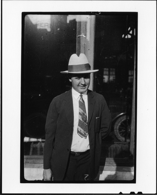 Tennessee v. John T. Scopes Trial: Unidentified man in front of auto dealership, Dayton, Tennessee.