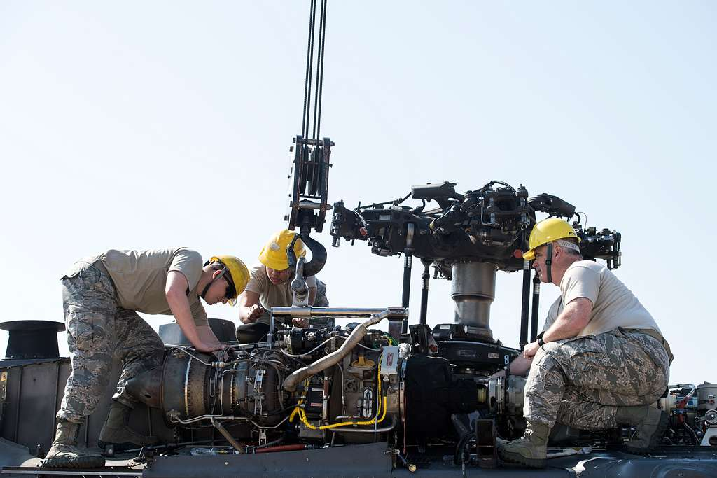 Airmen from the 41st Helicopter Maintenance Unit install