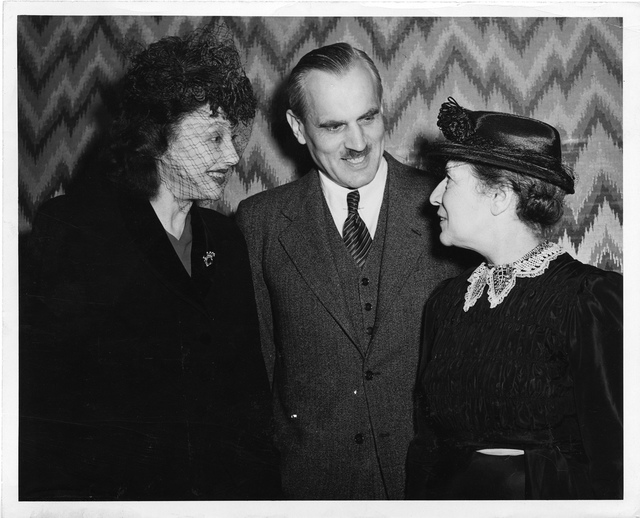 Lise Meitner (1878-1968), standing at meeting with Arthur H. Compton and Katherine Cornell