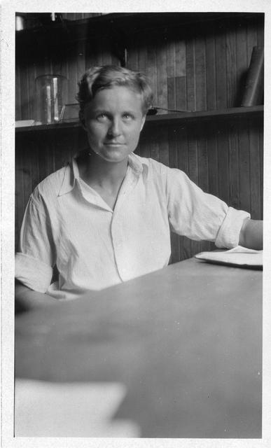 Muriel A. Case (1901-1981), sitting in lab