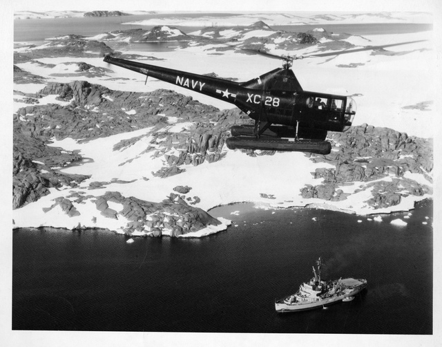 Navy Helicopter Flying Over Antarctica