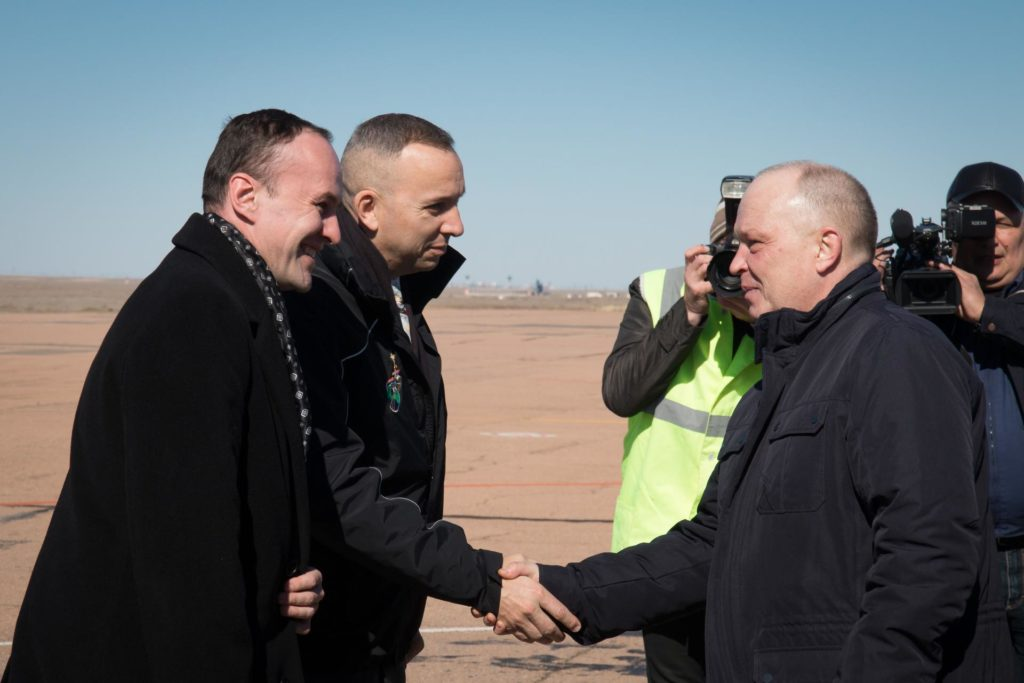 jsc2017e039900 (04/05/2017) --- Expedition 51 backup crewmembers Sergey Ryazanskiy of the Russian Federal Space Agency (Roscosmos, left) and Randy Bresnik of NASA are greeted by Russian space officials after arriving at the launch site in Baikonur, Kazakhstan April 5 for final pre-launch training after a flight from the Gagarin Cosmonaut Training Center in Star City, Russia. They are serving as backups to Jack Fischer of NASA and Fyodor Yurchikhin of Roscosmos who will launch April 20 on the Soyuz MS-04 spacecraft for a four and a half month mission on the International Space Station. Photo: NASA/Victor Zelentsov jsc2017e039900