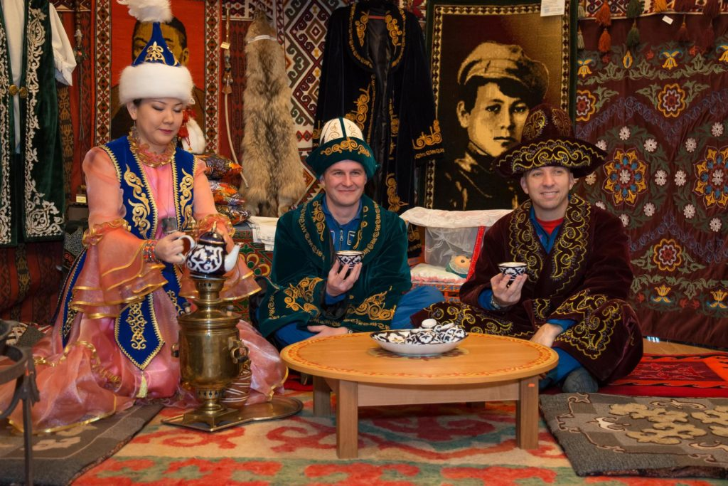 "jsc2017e040350 (April 7, 2017) --- In Baikonur, Kazakhstan, Expedition 51 backup crewmembers Sergey Ryazanskiy of the Russian Federal Space Agency (Roscosmos, center) and Randy Bresnik of NASA (right) sample local tea in a traditional Kazakh ""yurt"" or tent April 7 while wearing traditional Kazakh robes and hats. They are serving as backups to Fyodor Yurchikhin of Roscosmos and Jack Fischer of NASA, who will launch April 20 on the Soyuz MS-04 spacecraft from the Baikonur Cosmodrome for a four and a half month mission on the International Space Station. NASA/Victor Zelentsov jsc2017e040350"