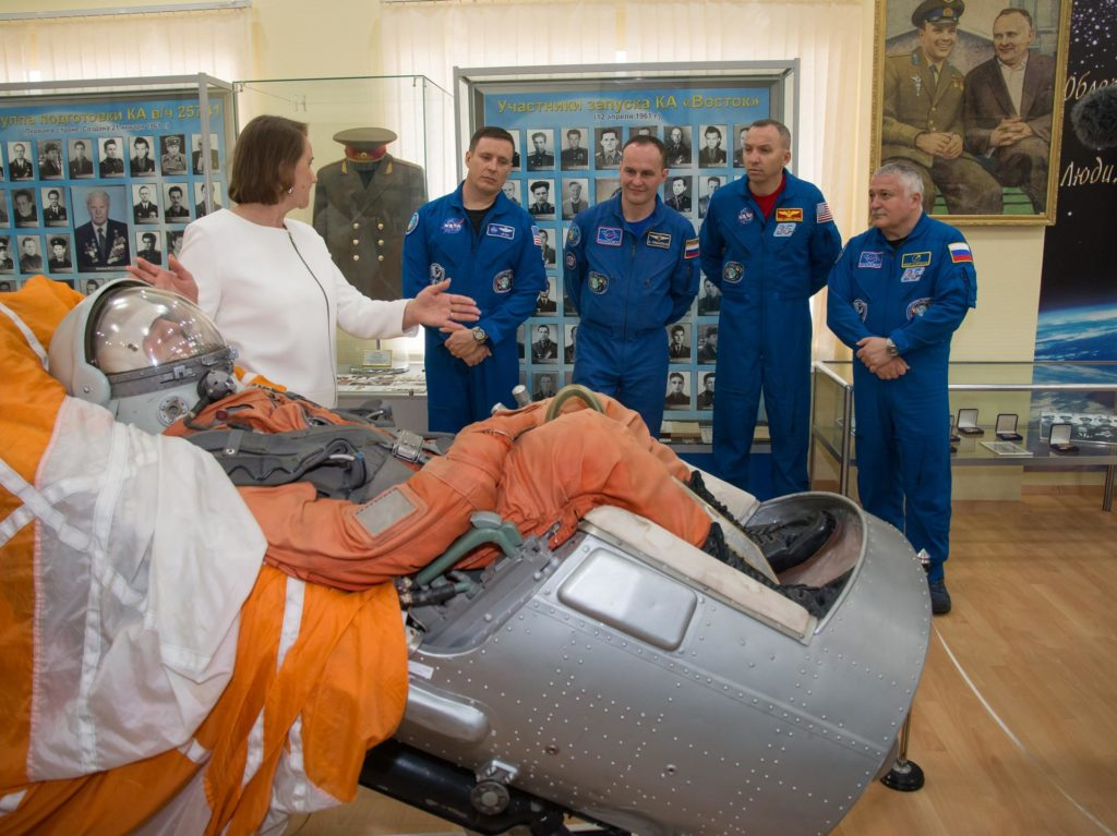 jsc2017e043851 (April 14, 2017) --- At the Baikonur Cosmodrome Museum in Kazakhstan, the Expedition 51 prime and backup crewmembers are shown a replica of a Soyuz seat and passenger April 14 during a traditional tour of the facility. From left to right are prime crewmember Jack Fischer of NASA, backup crewmember Sergey Ryazanskiy of the Russian Federal Space Agency (Roscosmos), backup crewmember Randy Bresnik of NASA and prime crewmember Fyodor Yurchikhin of Roscosmos. Fischer and Yurchikhin will launch April 20 on the Soyuz MS-04 spacecraft for a four and a half month mission on the International Space Station. Credit: NASA/Victor Zelentsov jsc2017e043851
