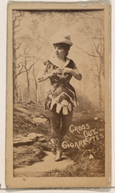 Actress posing in studio forest scene, from the Actors and Actresses series (N145-1) issued by Duke Sons & Co. to promote Cross Cut Cigarettes