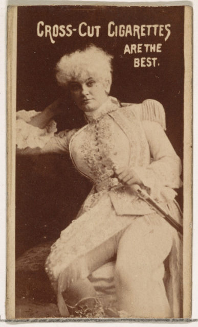 Actress wearing costume with white wig and sword, from the Actors and Actresses series (N145-1) issued by Duke Sons & Co. to promote Cross Cut Cigarettes
