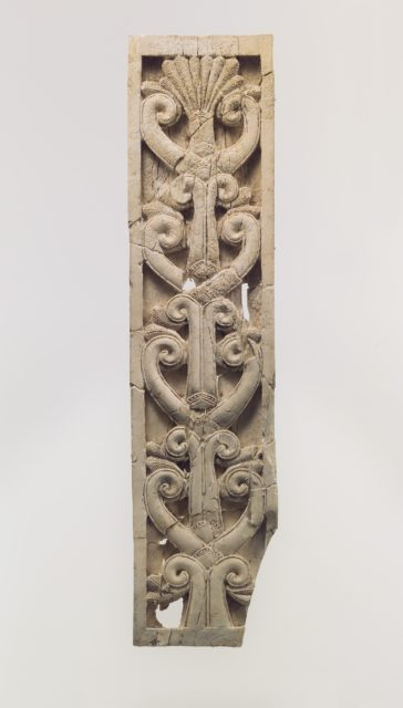 Furniture plaque carved in relief with volutes and palmette