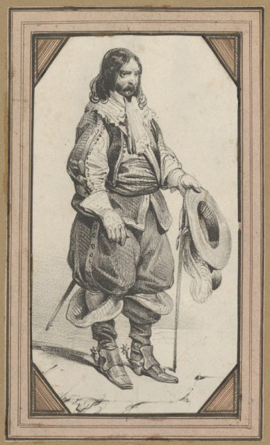 Man holding a cane and a hat