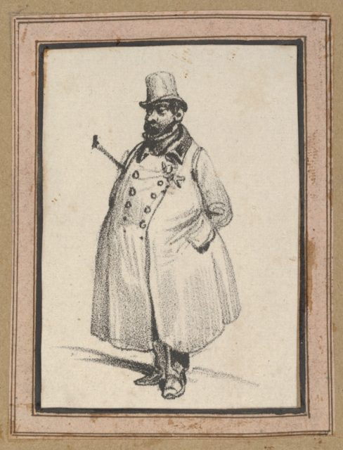 Man wearing a coat and a hat with a cane under his arm