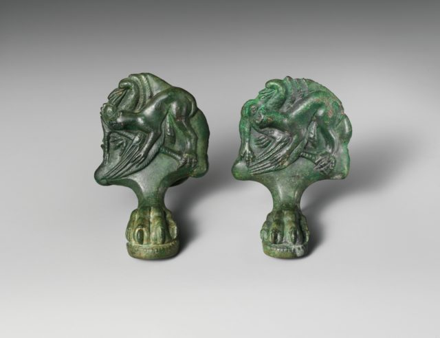 Pair of bronze cista (toiletries box) feet with panthers attacking cranes