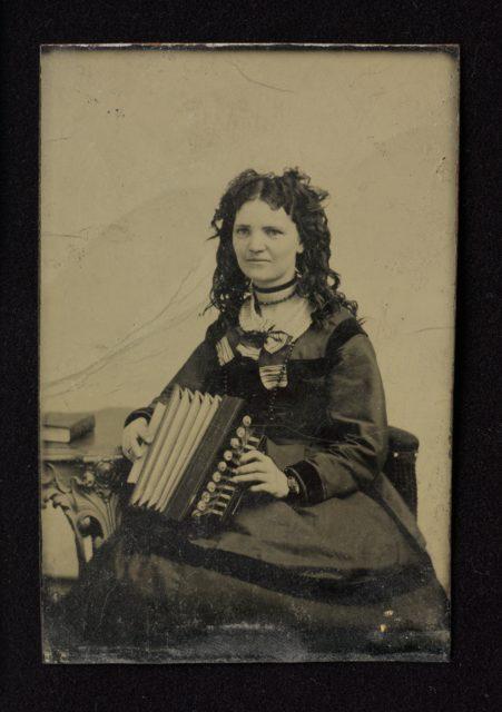 Woman Holding an Accordion tintype