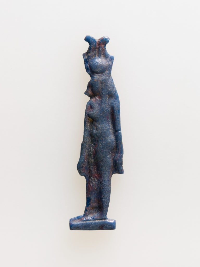 Amulet of cow-headed goddess with feathers atop disk and horns