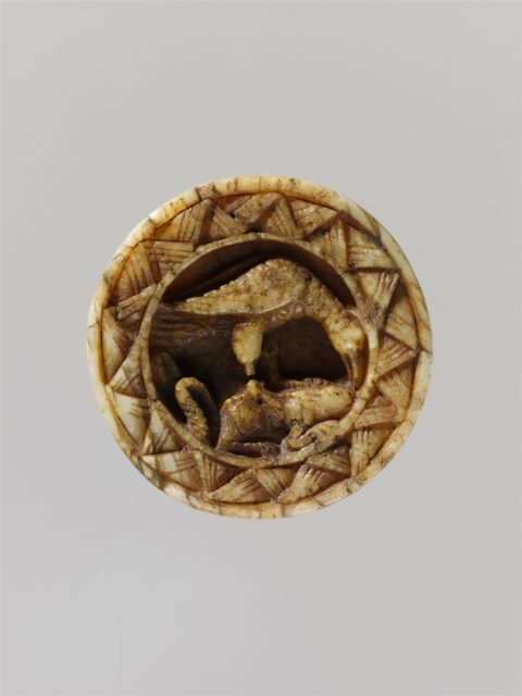 Game Piece with an Eagle Attacking a Hare