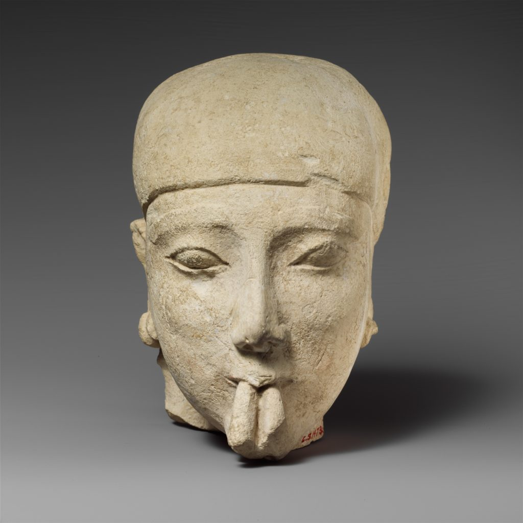 Limestone head of a male aulos player