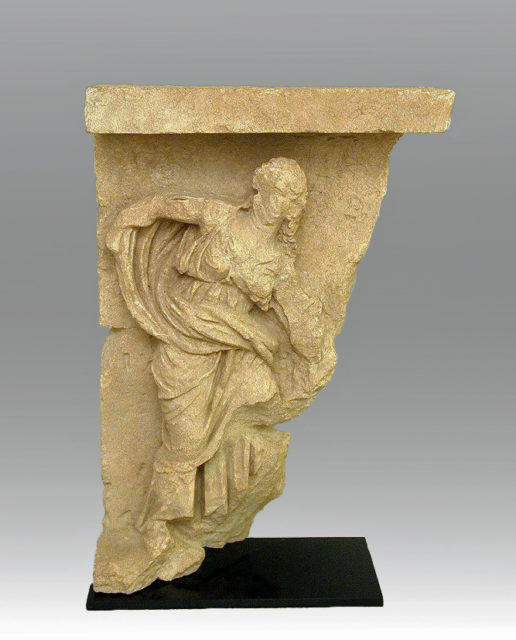Limestone relief with the figure of a woman