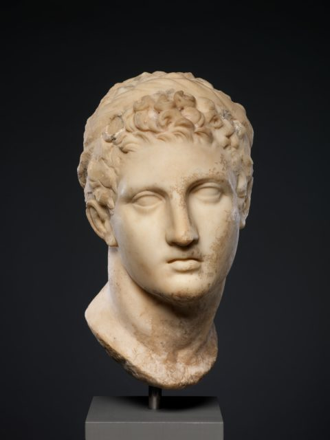 Marble head of a horned youth wearing a diadem