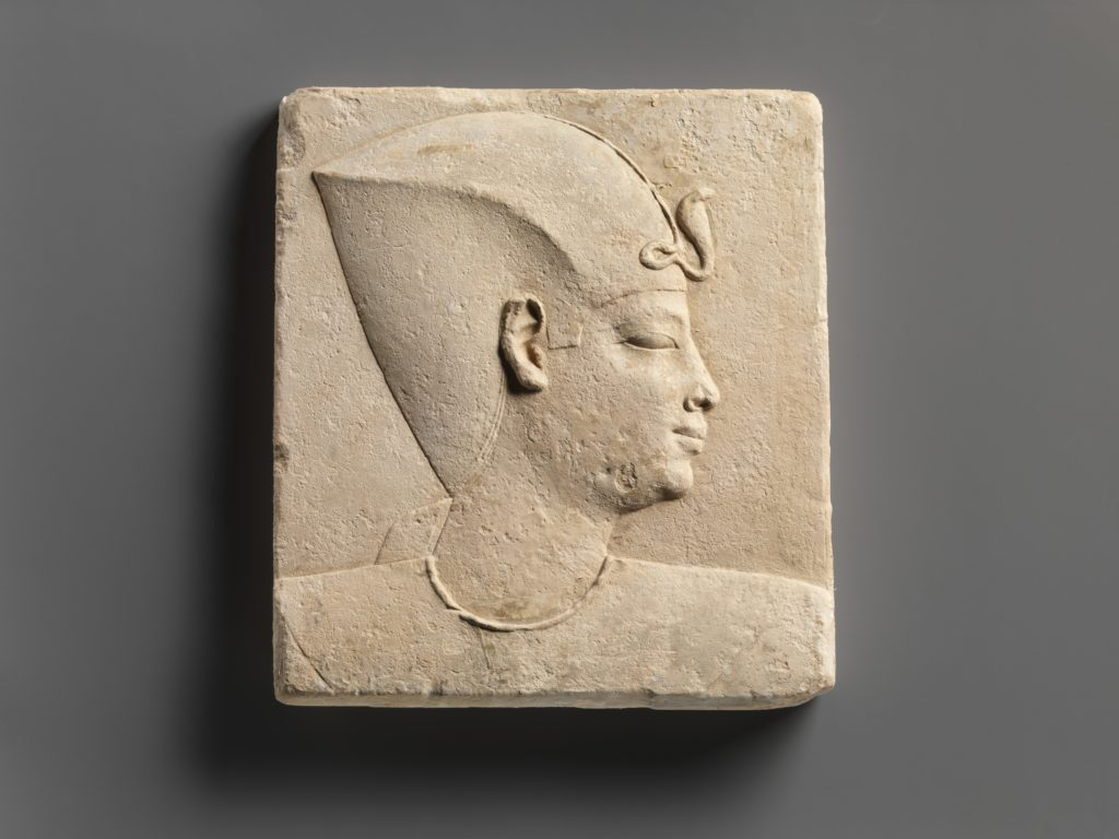 Relief of king's head in blue crown, head of child god on opposite side
