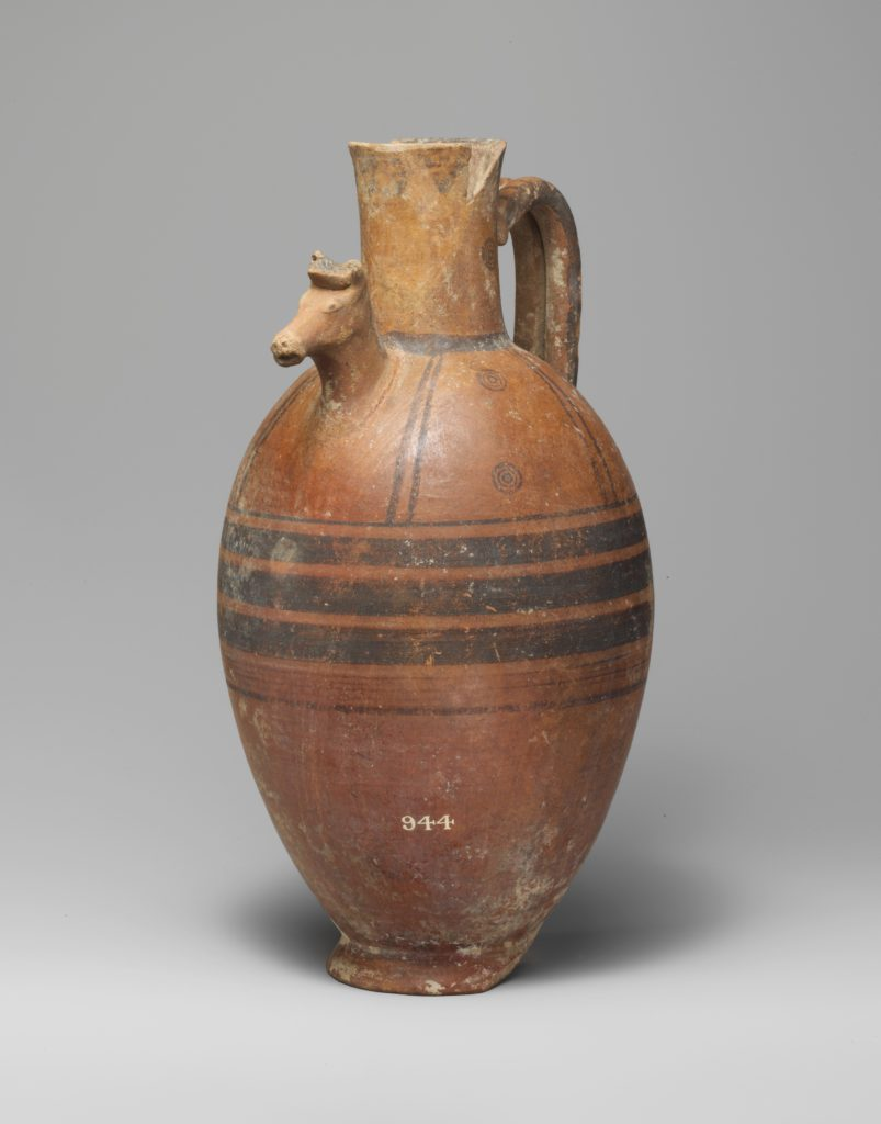 Terracotta jug with horse's head in relief