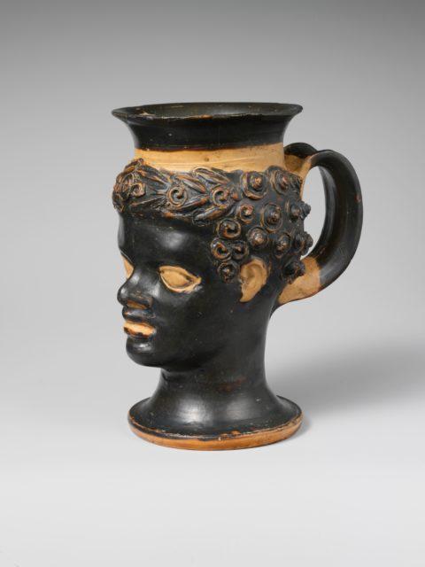 Terracotta mug in the form of a black African boy's head