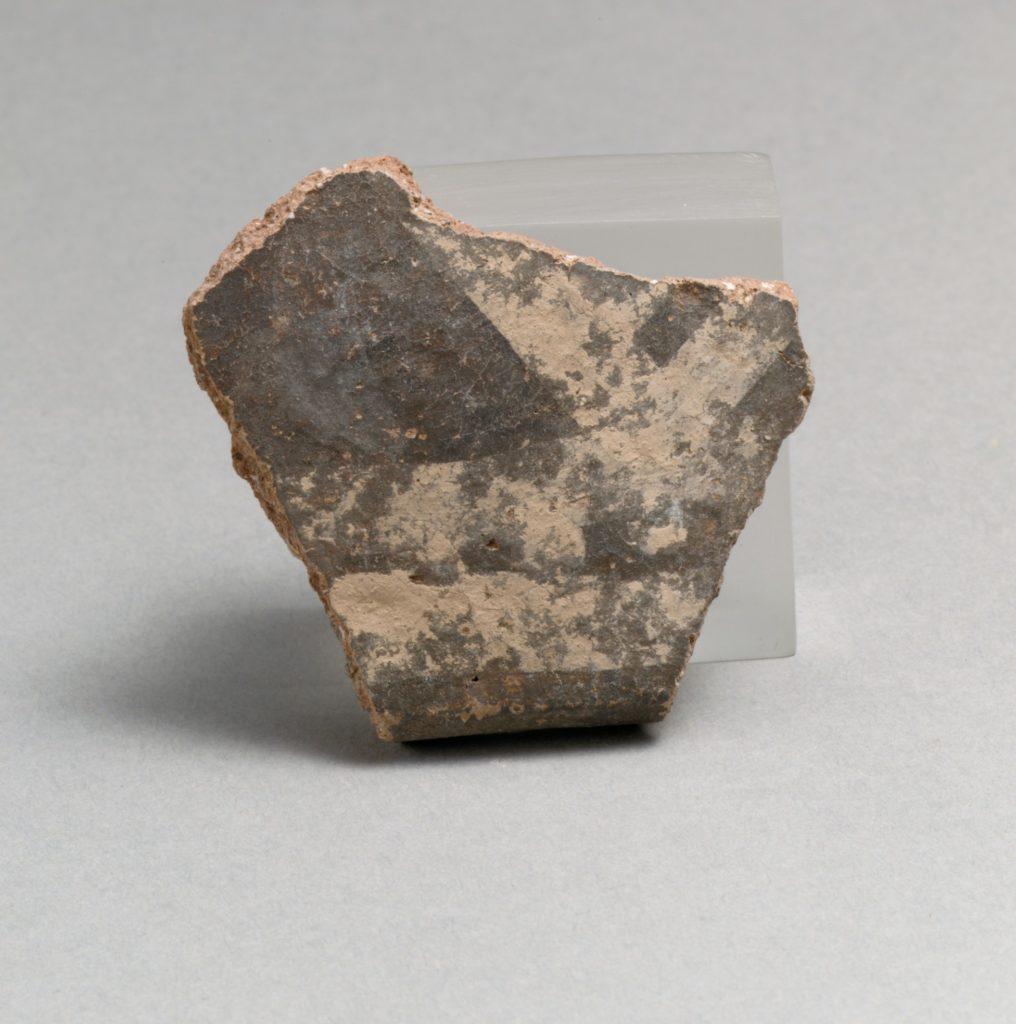 Terracotta rim fragment with linear motifs