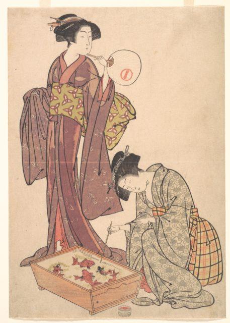 Two Women Feeding Fish