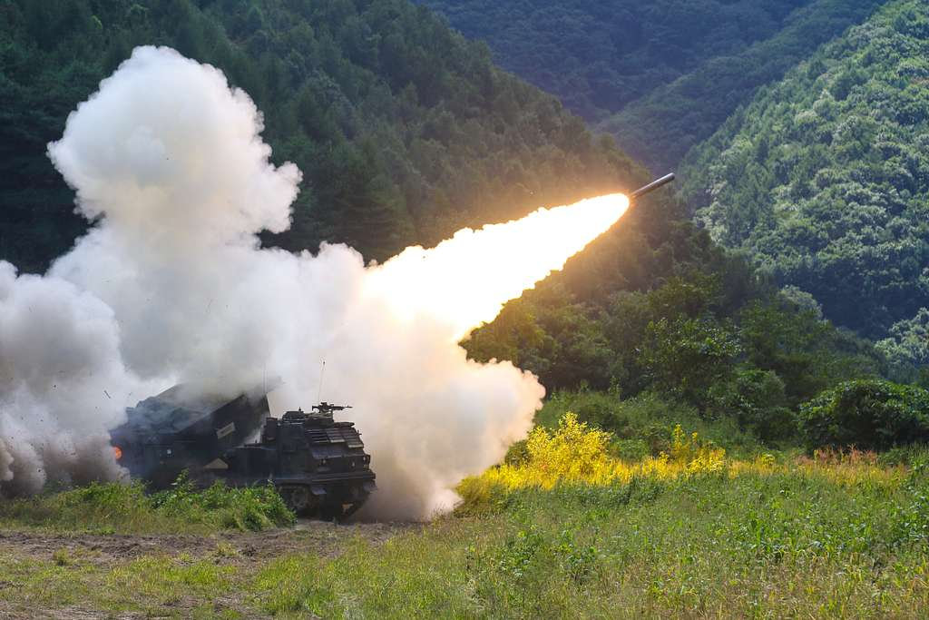 An M270 multiple launch rocket system fires during