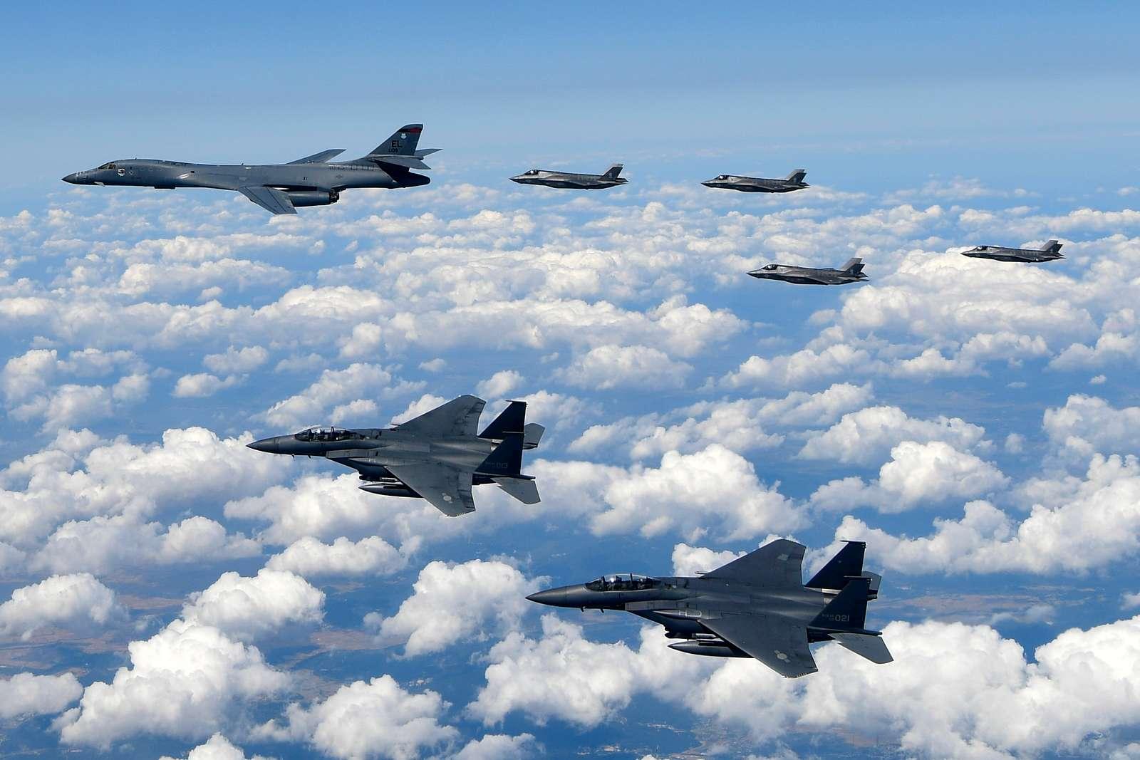 Rockwell B-1B Lancer with McDonnell Douglas F-15 Eagles and Lockheed Martin Aeronautics YF-22 Raptors