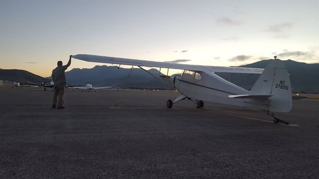Chris Bergen does final walkaround at Heber Airport, Heber UT.