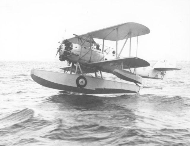 Vought O3U-1 A-8836 testing Grumman Model B amphibious float 80-G-4022