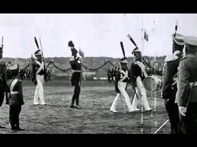 Emperor Nicholas II and Tsesarevich Alexei are taking a military parade.Tsarskoe Selo. 1913 year.