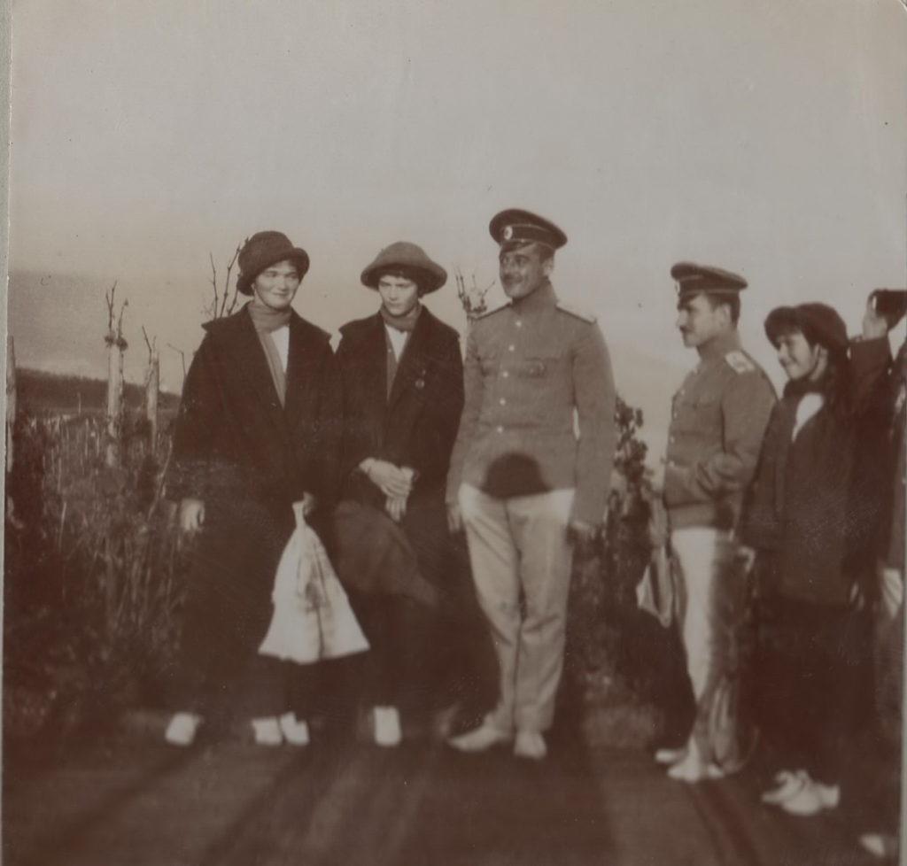 Daughters of Emperor Nicholas II Grand Princesses Olga, Tatiana and Anastasia on a walk with accompanying officers.