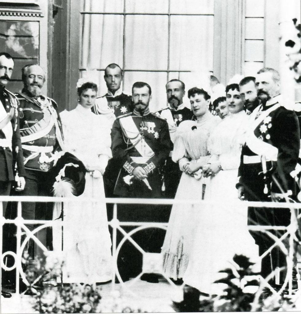 Emperor Nicholas II and Empress Alexandra Feodorovna surrounded by relatives.