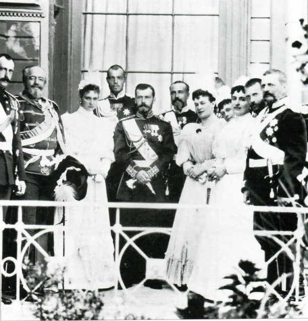 Emperor Nicholas II and Empress Alexandra Feodorovna surrounded by relatives.