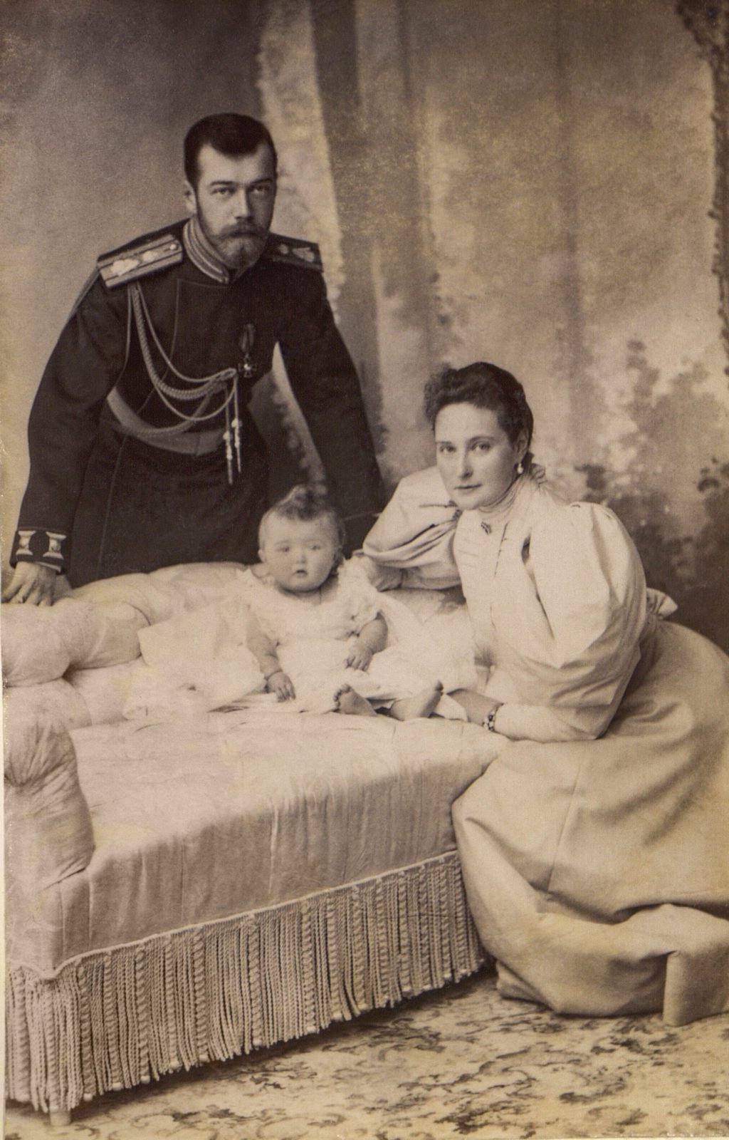 Emperor Nicholas II and Empress Alexandra Feodorovna with her daughter Grand Duchess Olga Nikolaevna. 1896 year.