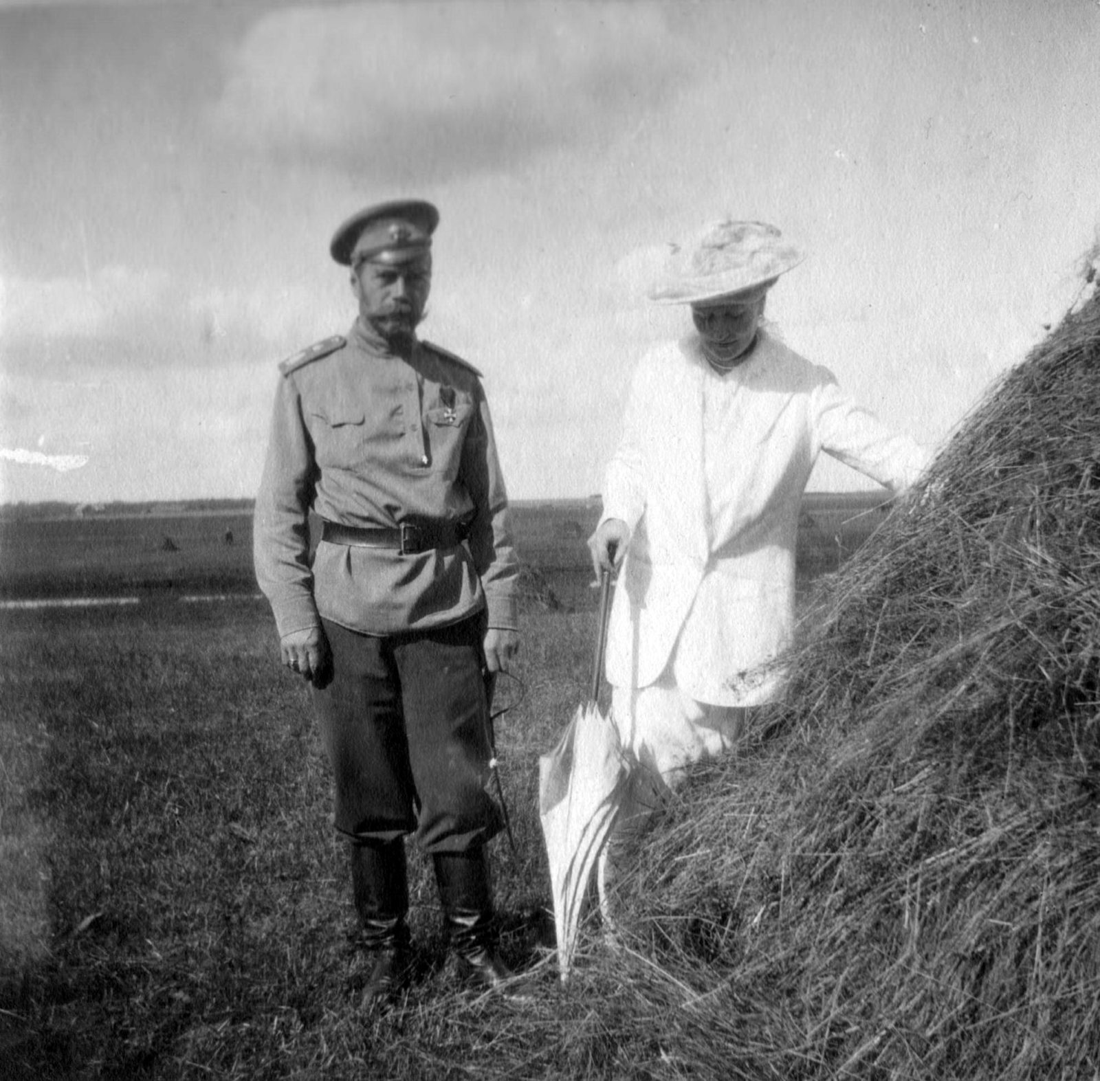 Emperor Nicholas II and Empress Empress Alexandra Feodorovna on a walk. Summer 1916.Near Mogilev.
