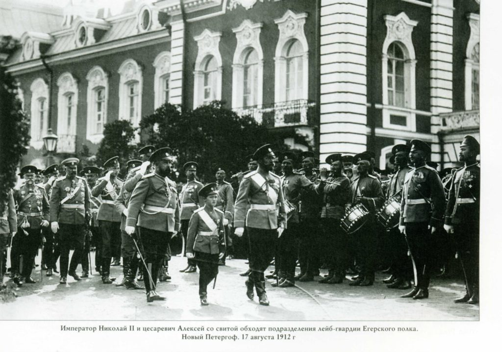 Emperor Nicholas II and Tsesarevich Alexei Nikolayevich with his suite bypass the formation of the Life Guards Regiment of the Jaeger Regiment.