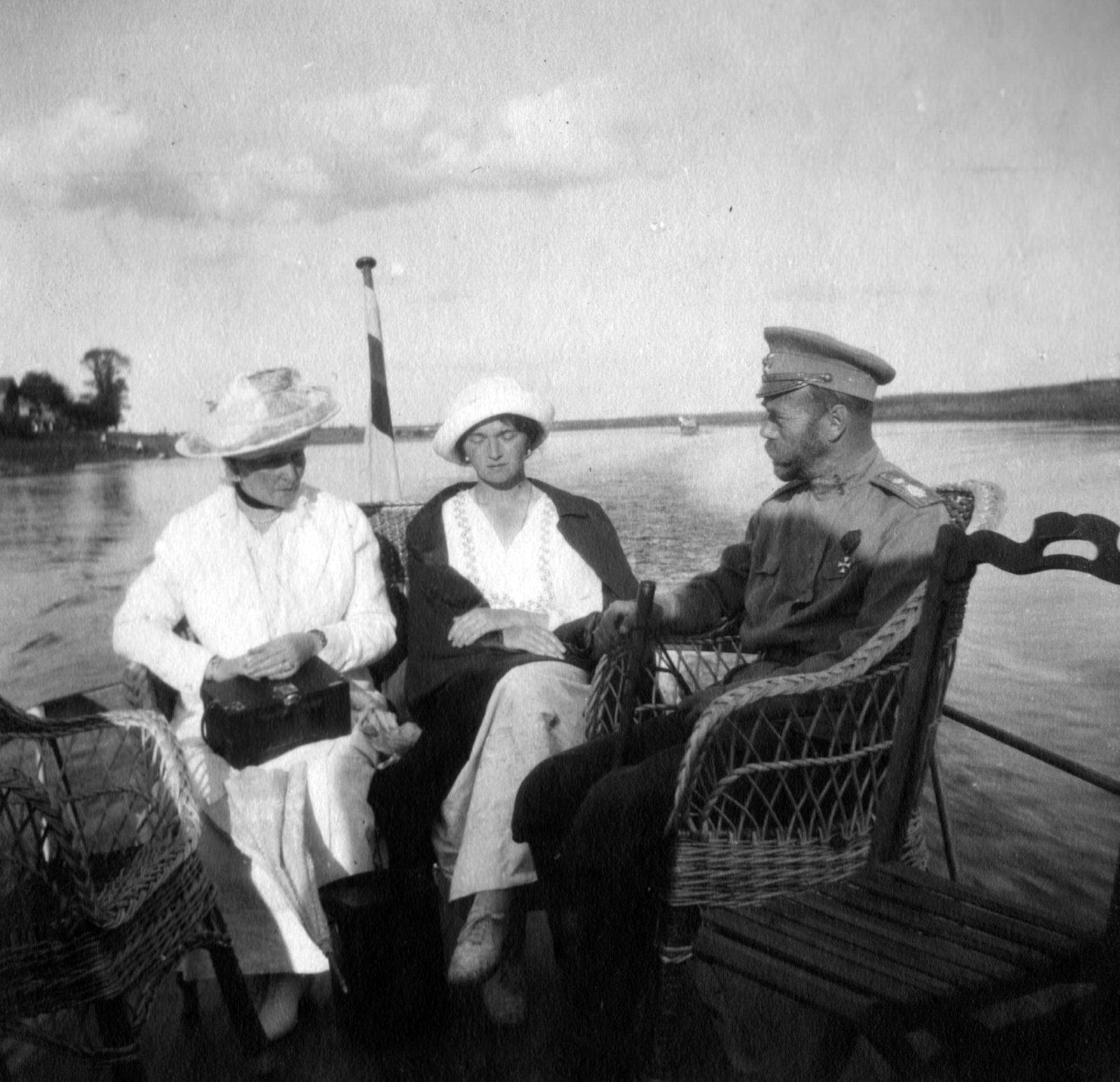 Emperor Nicholas II, Empress Alexandra Feodorovna, Grand Princess Olga. Summer 1916.Near Mogilev.