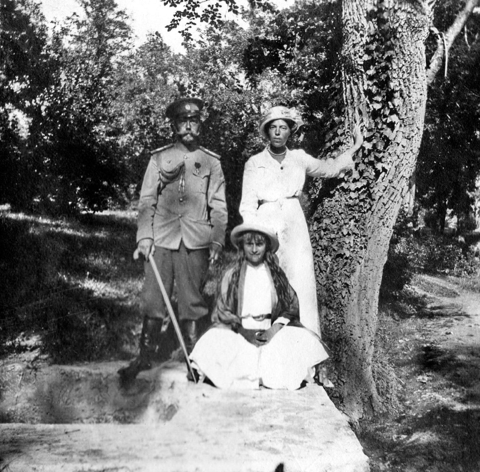 Emperor Nicholas II, Grand Duchess Olga Alexandrovna and Grand Duchess Anastasia Nikolaevna on a walk.