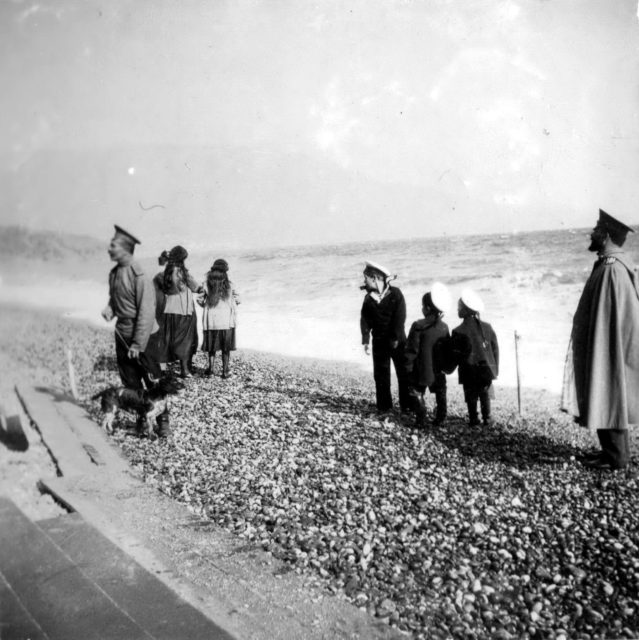 Emperor Nicholas II with children on the beach.