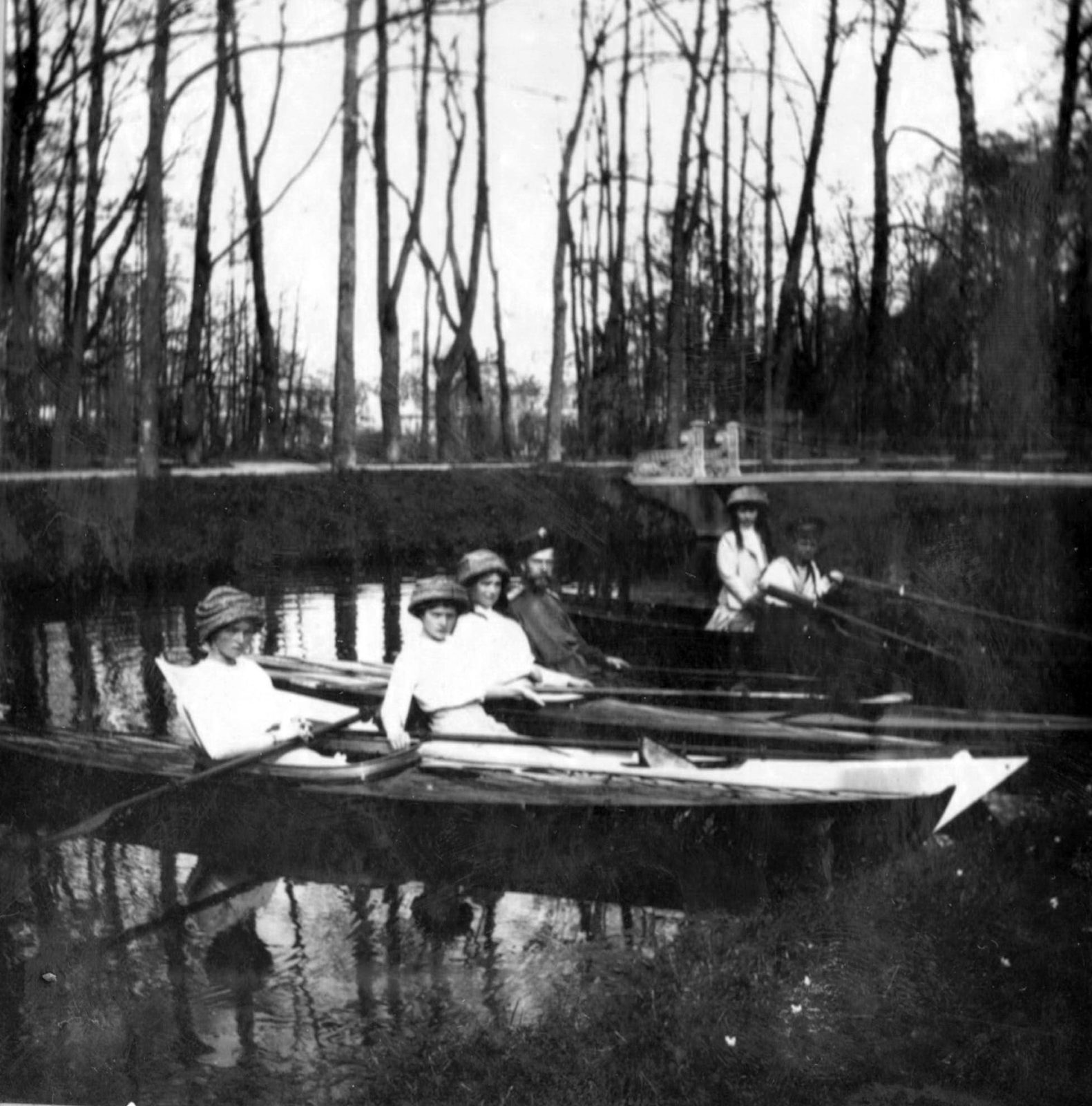 Emperor Nicholas II with his children. Canoeing on the canal of the Tsarskoe Selo Park.
