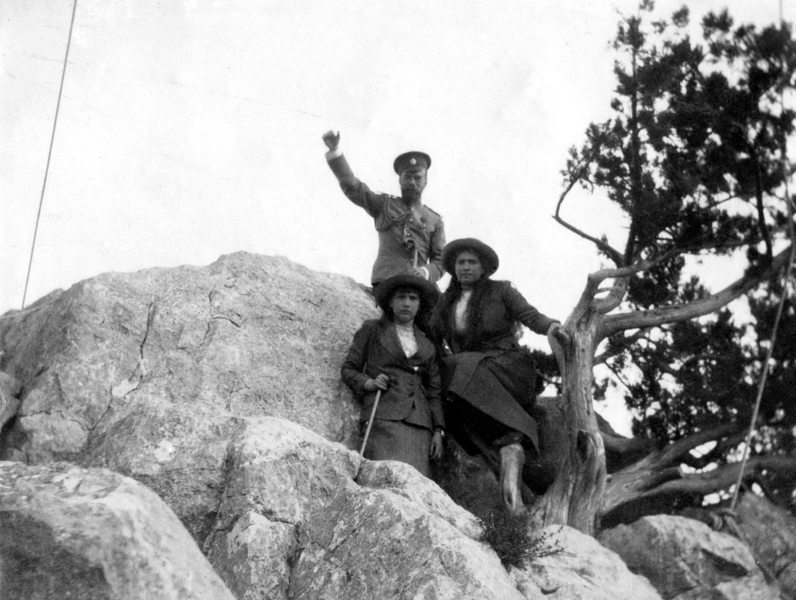 Emperor Nicholas II with his daughters Grand Dukes Maria and Anastasia during a walk. 1914 year.
